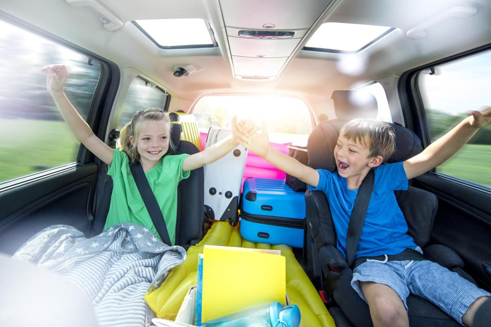 Children relax in the car during a long car journey