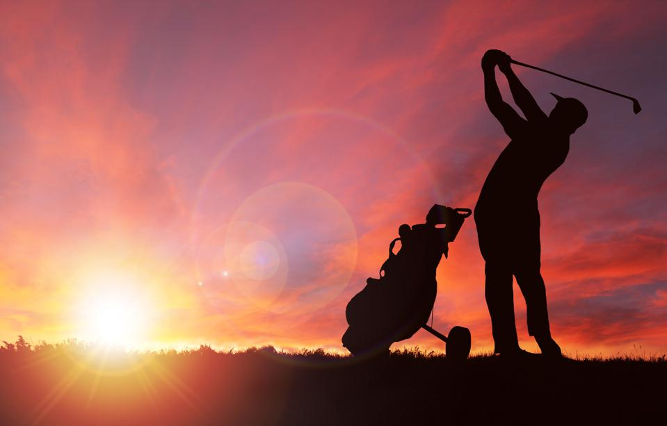 Golfer Silhouette During Sunset With Copy Space