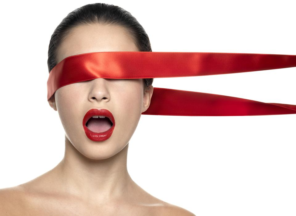 naked woman with red lips and red ribbon on her eyes