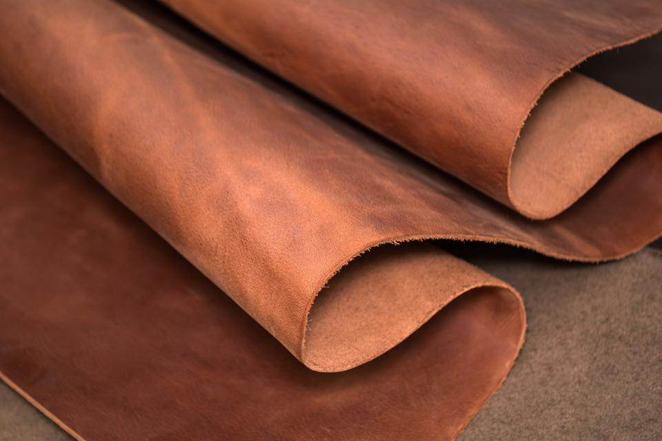 A piece of brown leather. Texture of natural material