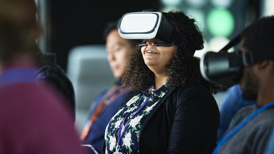 Woman with VR glasses at conference