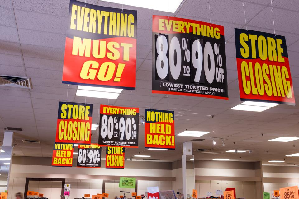 Store Closing, Everything Must Go  and huge discount signs at a store in liquidation.