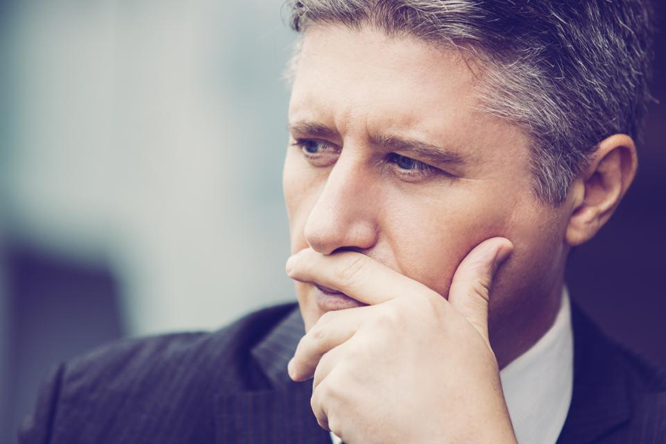 Close-up of pensive mature Caucasian businessman