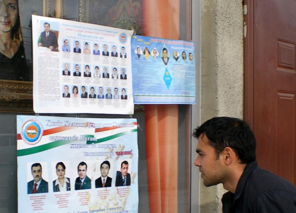 A Tajik man looking at parliamentary elections posters in central Dusahnbe on February 25, 2010.
