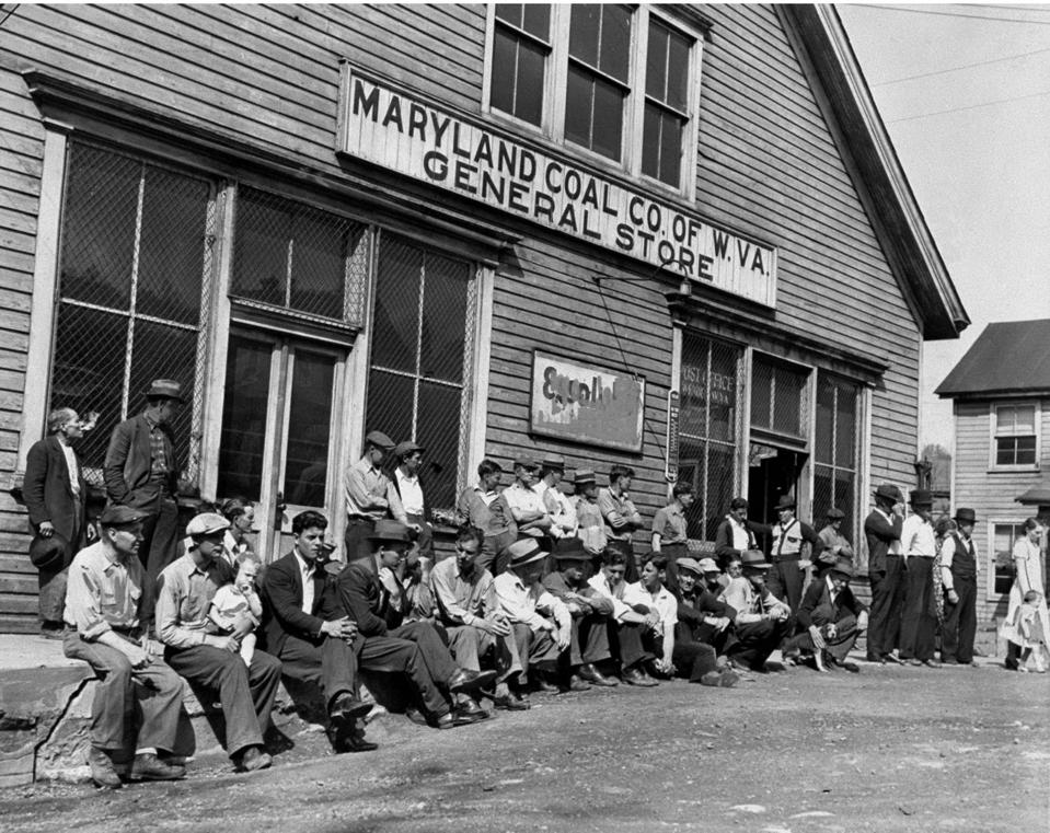 Maryland Coal Company miners loaf around in front of the com