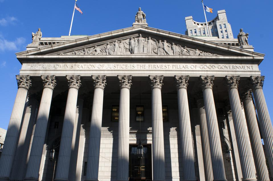 New York State Supreme Court building in Lower Manhattan showing the words 'The True Administration of Justice' on its facade in Manhattan.