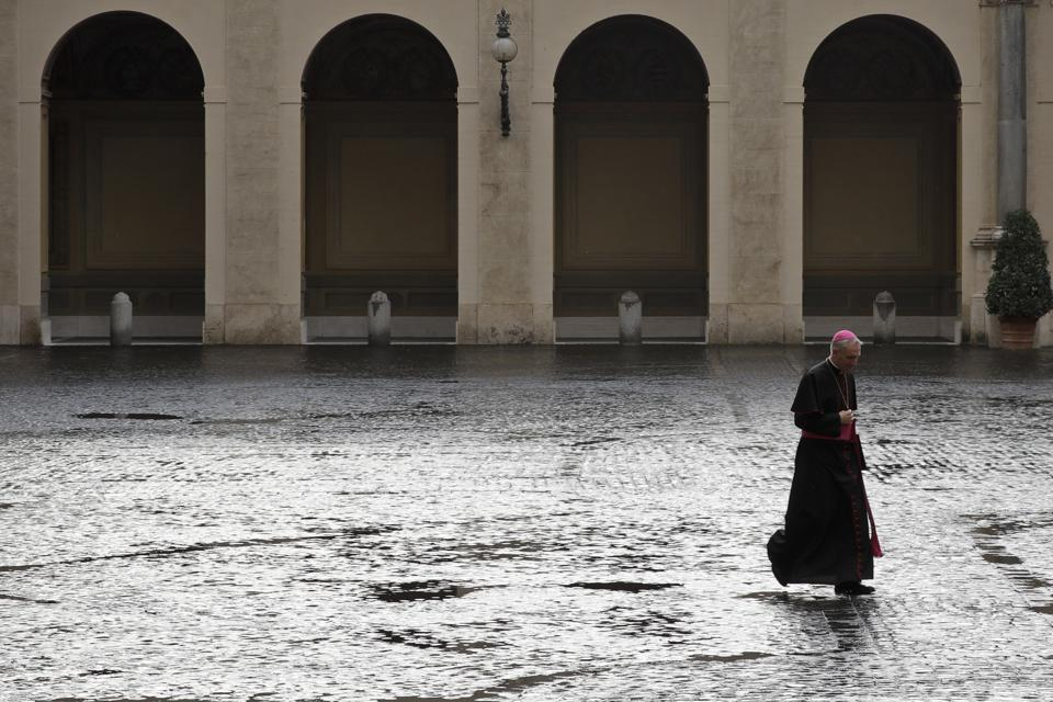 A prefect crosses the courtyard of San Damaso at the Vatican in November.