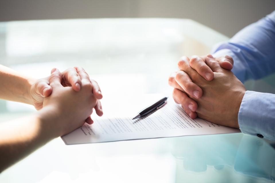 Two Businesspeople Hand With Document
