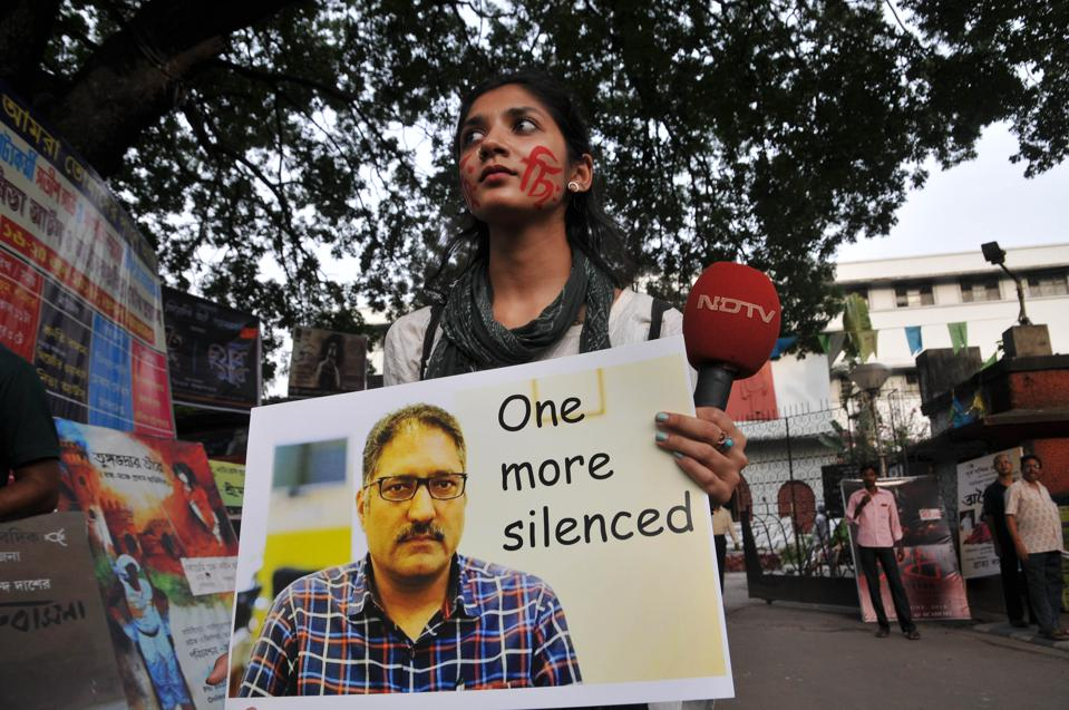 A silent prayer and protest for Shujaat Bukhari.
