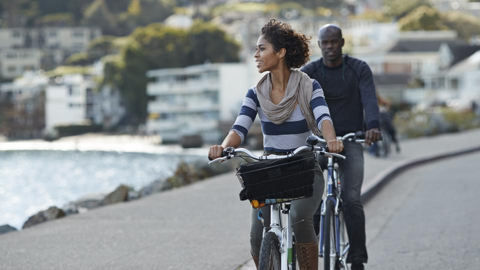 Holiday-making couple bicycle as a green activity during travel