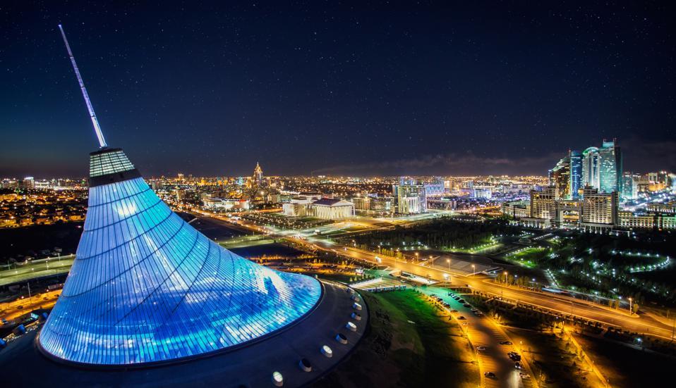 Illuminated Khan Shatyr Entertainment Center at night, Astana, Kazakhstan