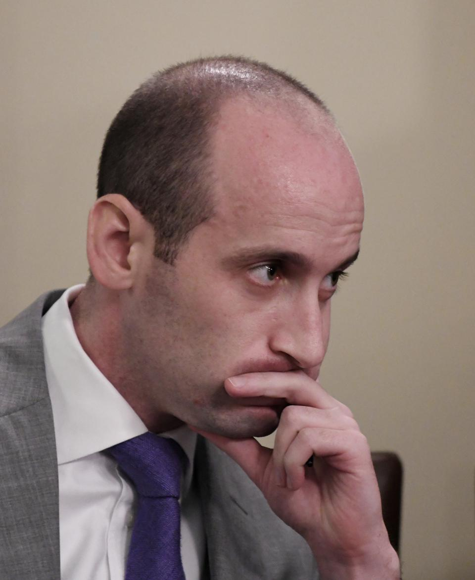 Picture of Stephen Miller, Trump's immigration advisor. He is sitting in a thoughtful pose