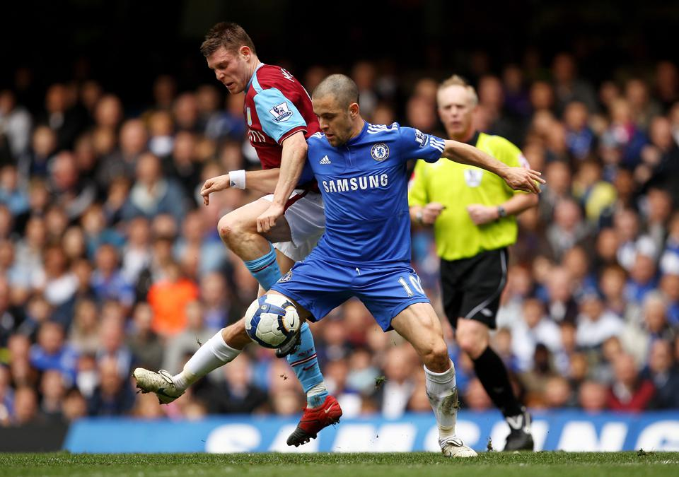 James Milner and Joe Cole compete in a Premier League match, Chelsea and Aston Villa