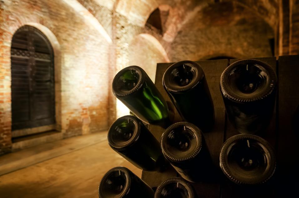 Pupitre and wine bottles inside an underground cellar