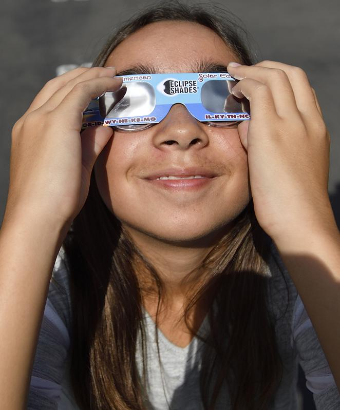 Solar eclipses glasses can be used to look at the Transit of Mercury. (Photo by Jeff Gritchen/Orange County Register via Getty Images)