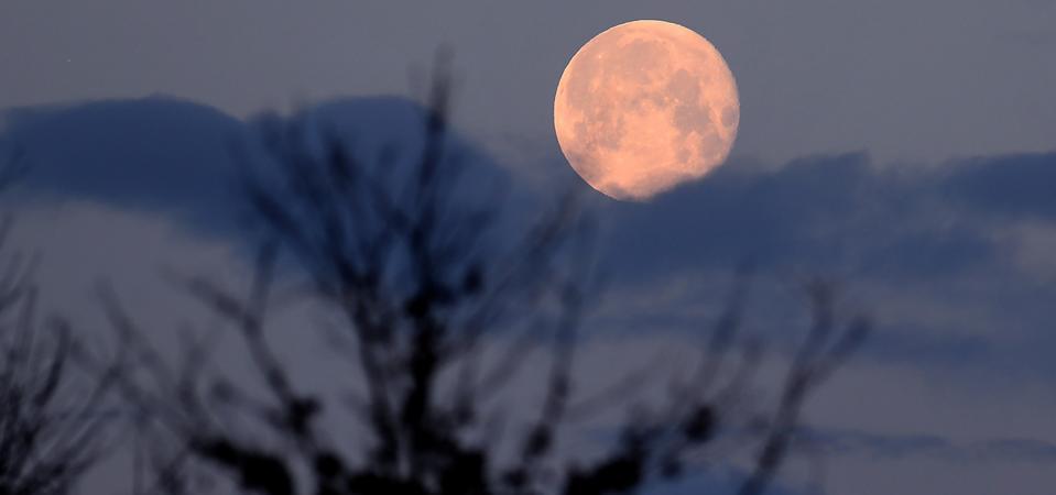 A nearly full moon sets over Langenhagen, Germany.