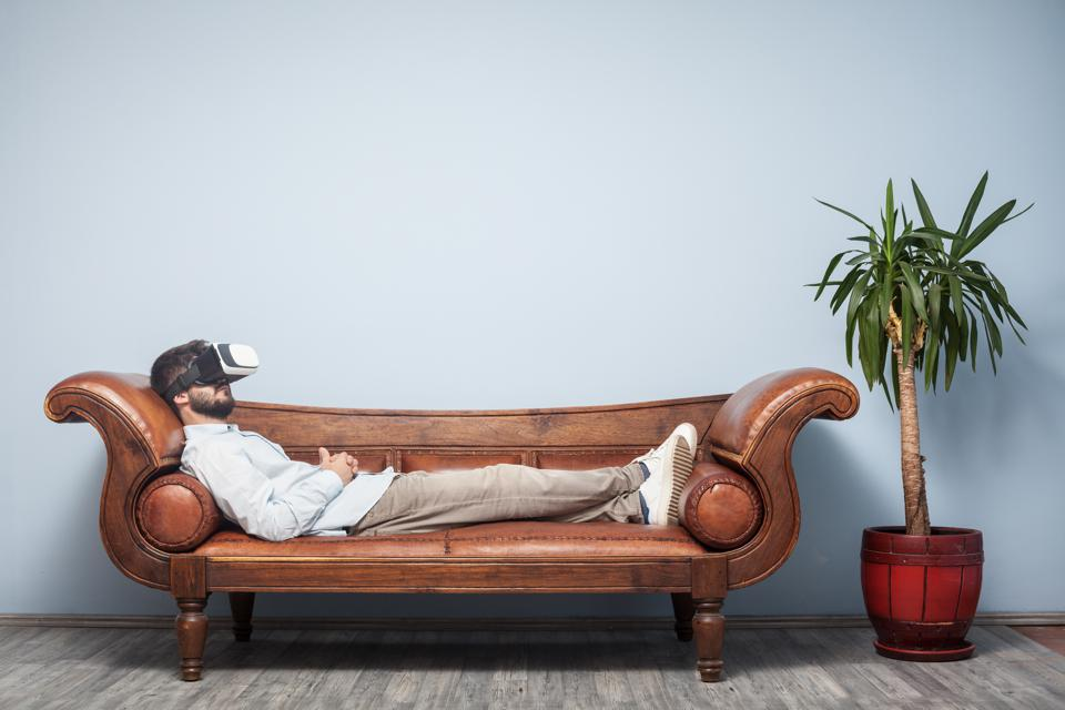 Adult Man With VR Headset Lying Down On Psychiatrist Couch