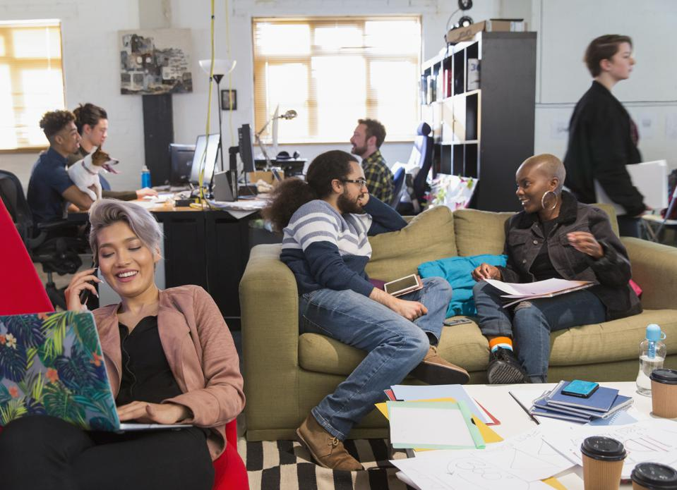 Creative business people meeting and working in casual, open plan office