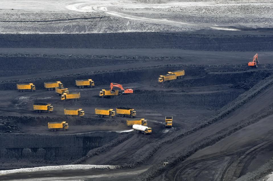 Trucks Transfer Raw Coal In East Junggar Basin
