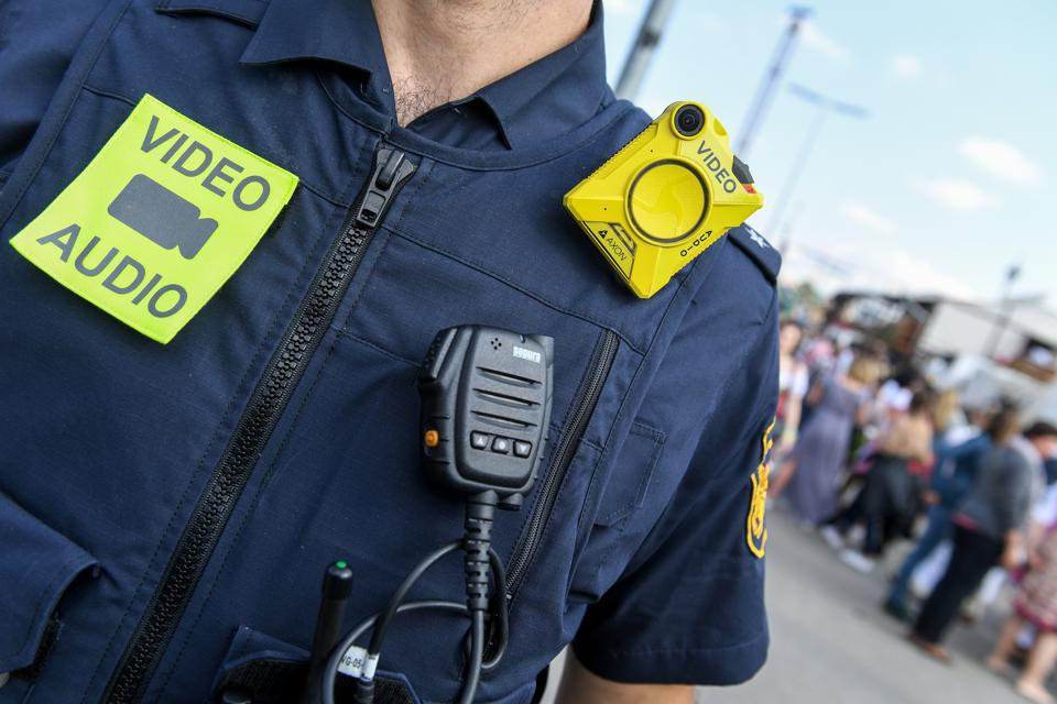 A police officer wearing a body camera  via Getty Images