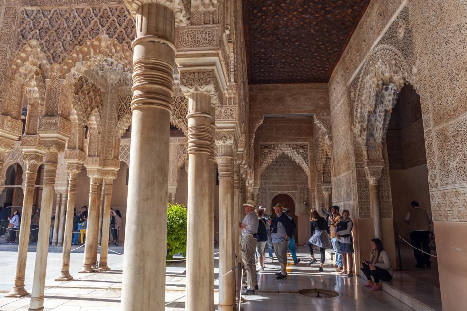 Columns line the Patio de los Leones in the Alhambra, a 13th...