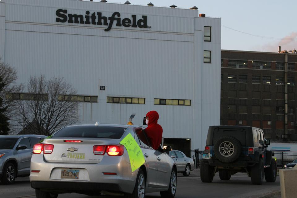 On April 9, employees and family members protested outside a large Smithfield Foods processing plant in South Dakota which has had an outbreak of coronavirus cases.