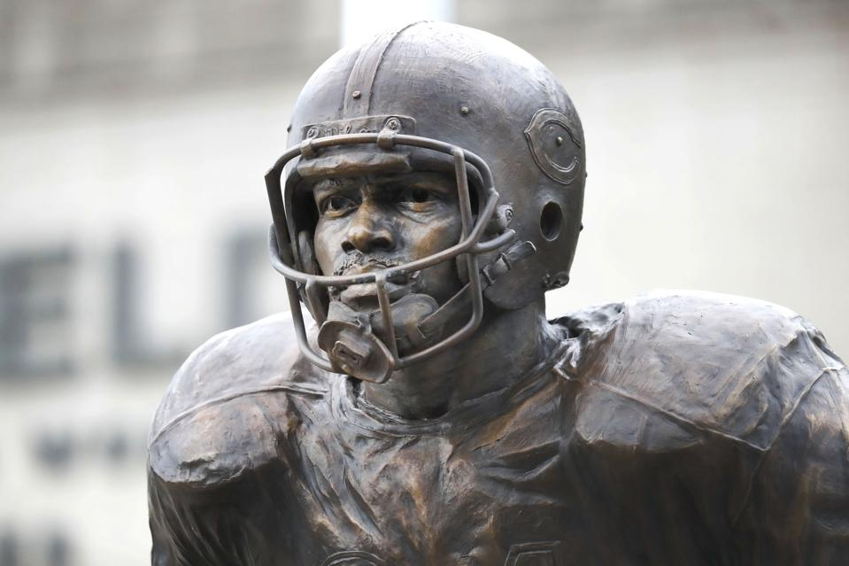 The newly dedicated statue of Chicago Bears and Pro Football Hall of Fame running back Walter Payton stands outside Soldier Field during a unveiling ceremony of statues honoring George Halas and Payton, Tuesday, Sept. 3, 2019, in Chicago. (Charles Rex Arbogast)