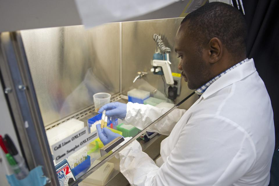 Ebola Scientist performing experiment for a vaccine.