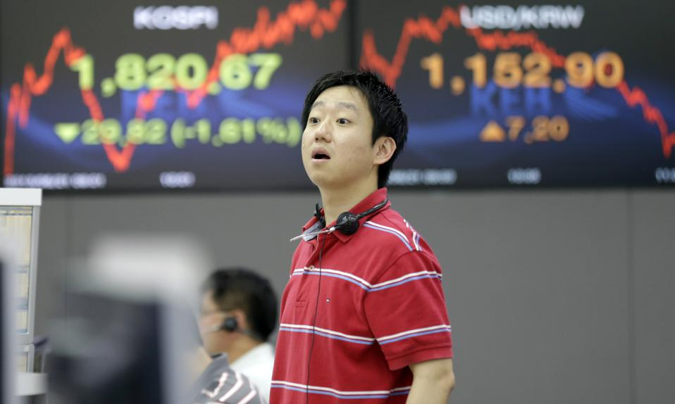 A trader reacts to falling Korean markets