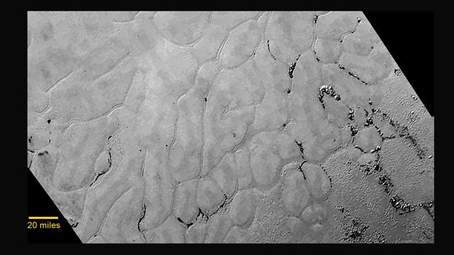 New Pluto Photos Show A Wind-Streaked Planet Smudged With Hydrocarbon Soot