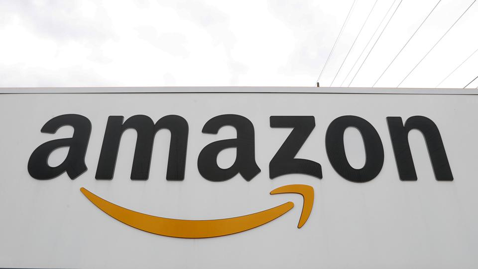 Amazon logo on front of warehouse in Michigan