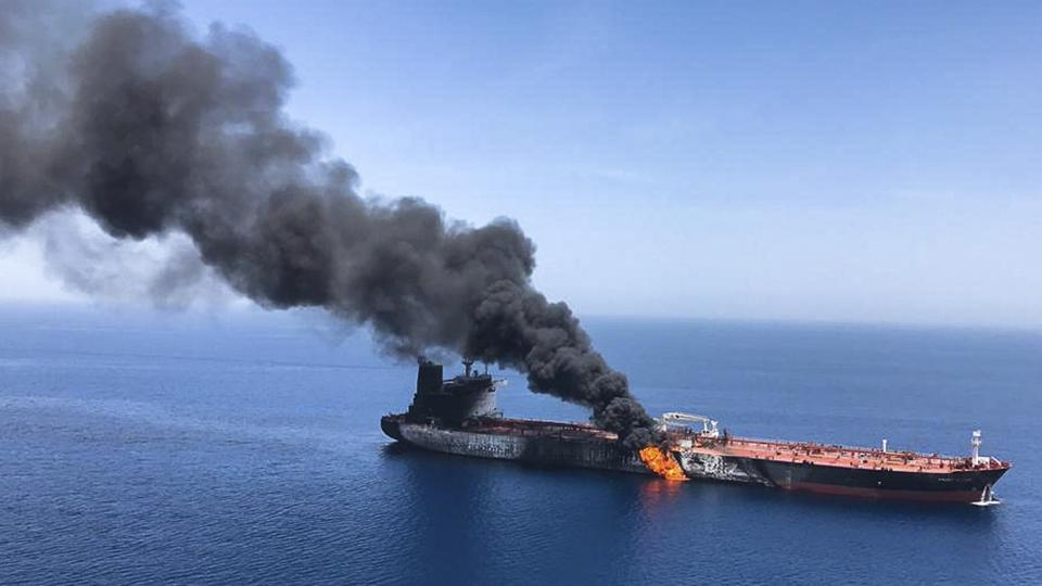 One of the two oil tankers burns in the Gulf of Oman, 14 nautical miles off of Iran's coast.