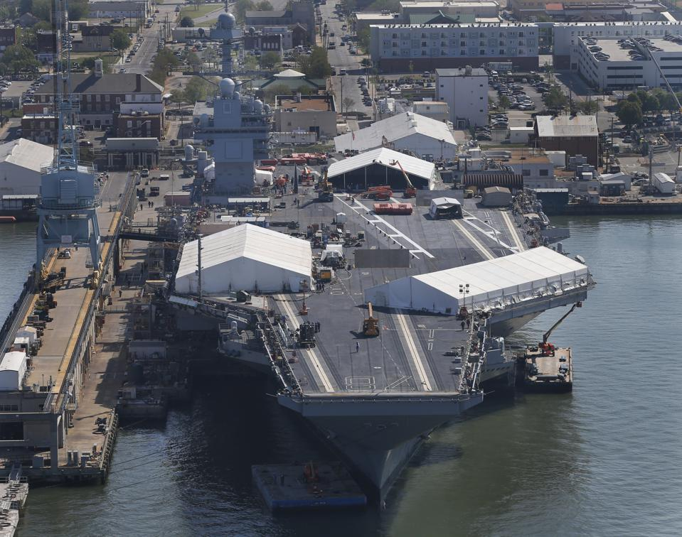 USS Gerald R. Ford in a shipyard