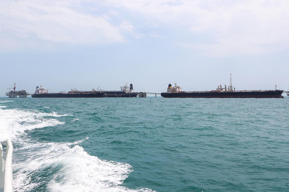 Two oil tankers loading at an offshore terminal in Iraq