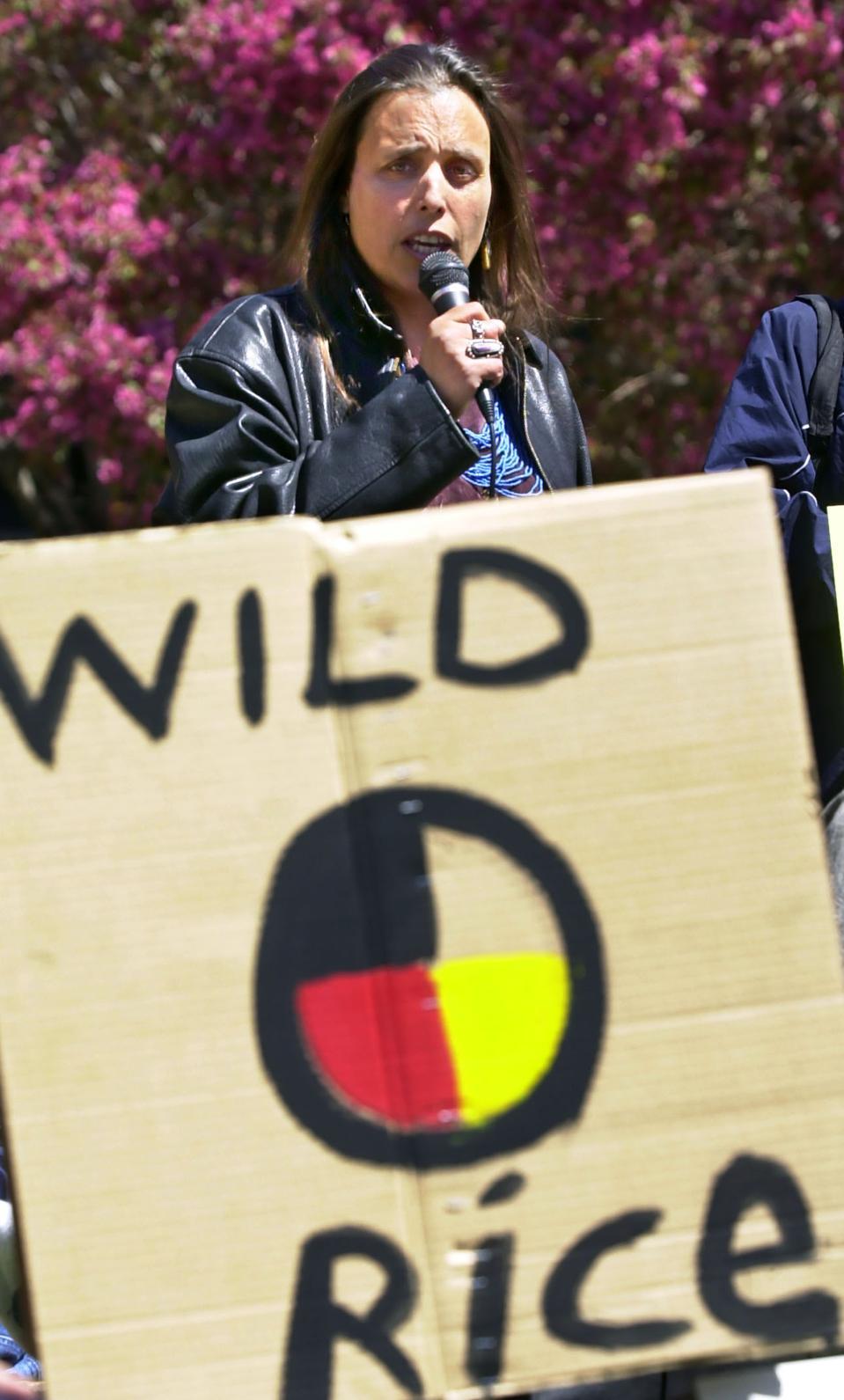 Winona LaDuke protesting genetically modified rice.