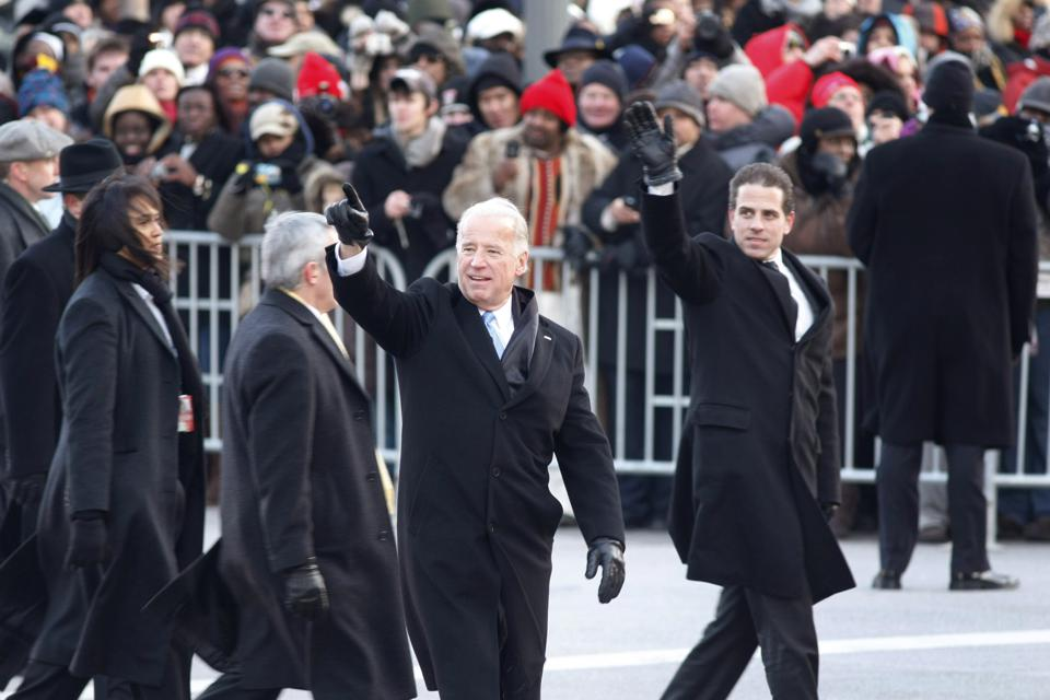 Vice President Joe Biden with his son Hunter Biden, right, wave to the crowd as they walk in the Inaugural Parade in January  2009.