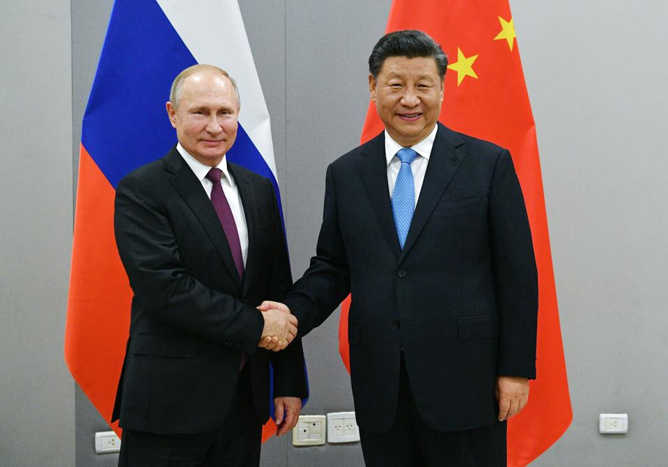 Two weeks ago, Russian President Vladimir Putin, left, and China's President Xi Jinping shook hands prior to their talks on the sideline of the 11th edition of the BRICS Summit, in Brasilia, Brazil. Brazil is now the leading supplier of soybeans to China and chicken to Russia, replacing the United States.