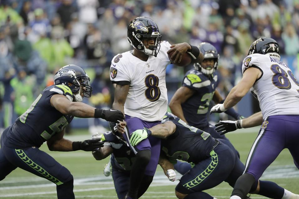 Baltimore Ravens' Lamar Jackson May Shatter Michael Vick's Single-Season Quarterback Rushing Record