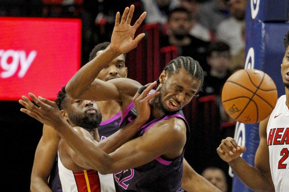 Dwyane Wade knocking the ball away from Andrew Wiggins in an April 5 game.
