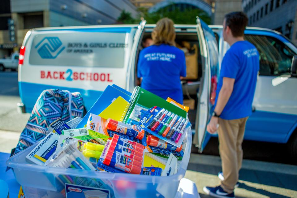 School supplies are piled outside of a Boys & Girls Club vehicle in Philadelphia.