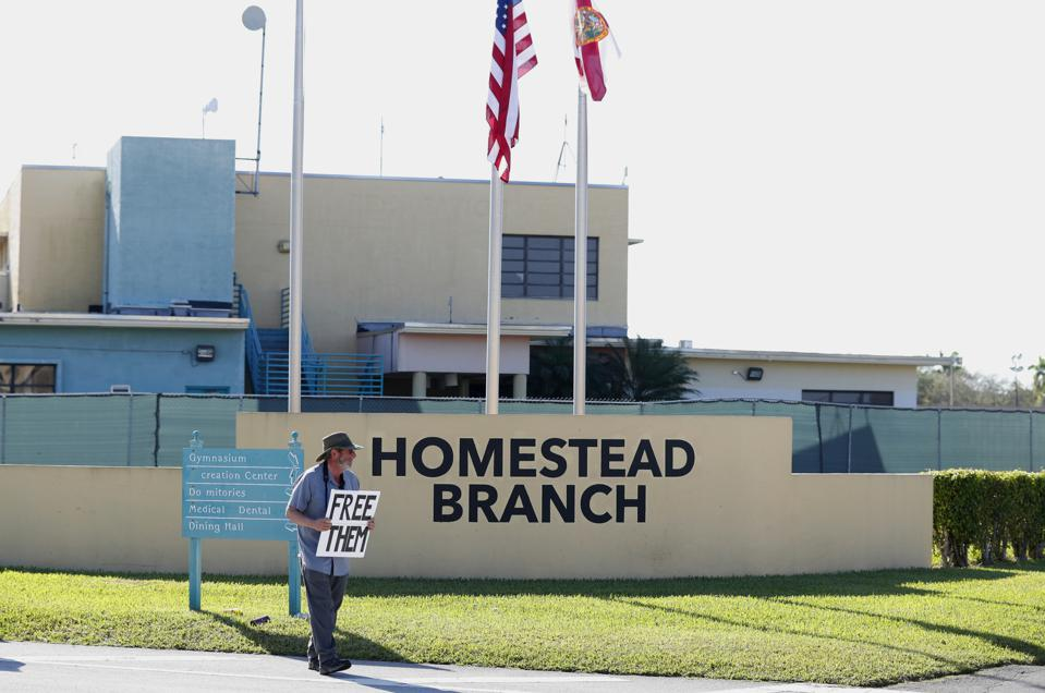 A protestor pickets outside the Homestead shelter.