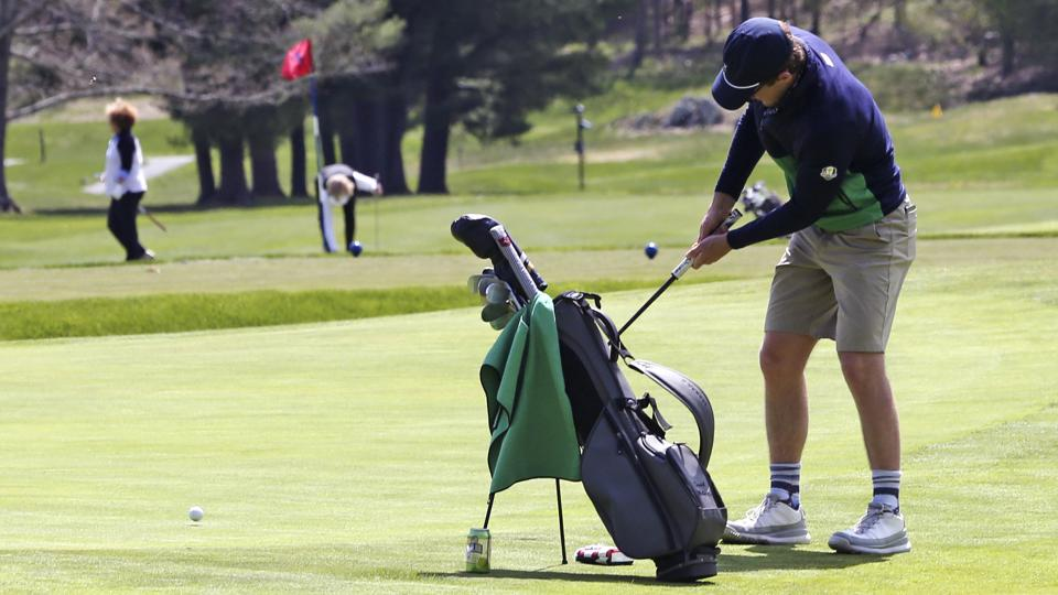 A man chips on to a green at the Weston Golf Club, in Weston, Mass., Thursday, May 7, 2020.