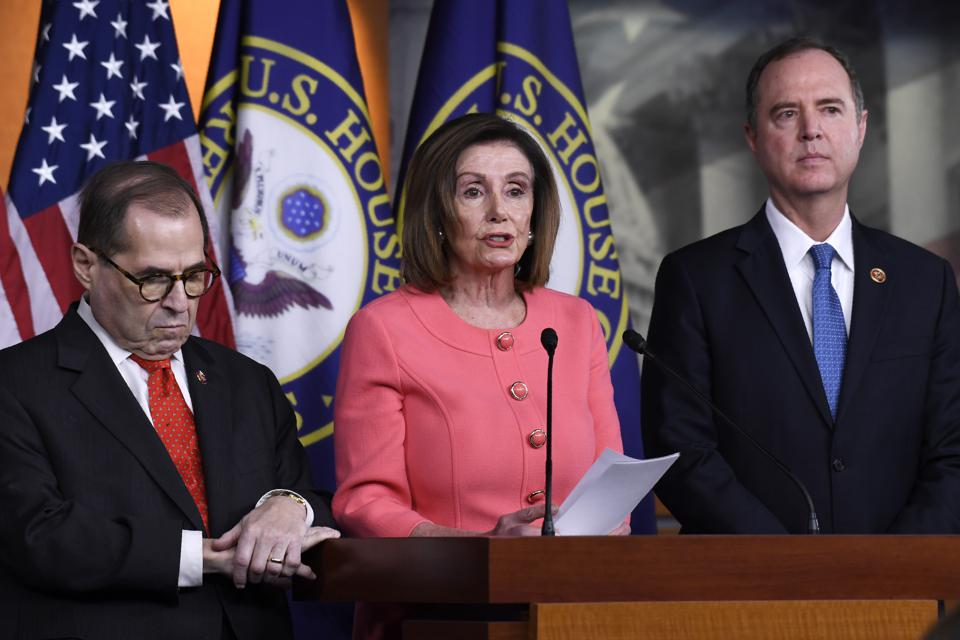 House Speaker Nancy Pelosi (D-CA) center, flanked by House Judiciary Committee Chairman Rep. Jerrold Nadler, (D-NY) left, and House Intelligence Committee Chairman Rep. Adam Schiff, (D-CA) at a press conference Wednesday.