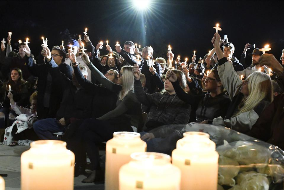 More than 2,000 people gathered on Monday night at a park in Amsterdam, New York, to honor the 20 victims of a deadly limousine crash as authorities turn their attention to the driver and the company that rented the vehicle.