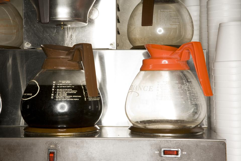 Coffee pots on brewing machine, close-up